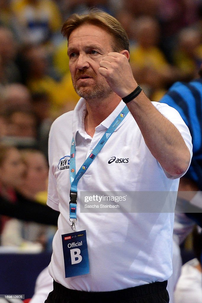 Head coach Martin Schwalb of Hamburg reacts during the EHF Final Four final match between FC Barcelona Intersport and HSV Hamburg at Lanxess Arena on...