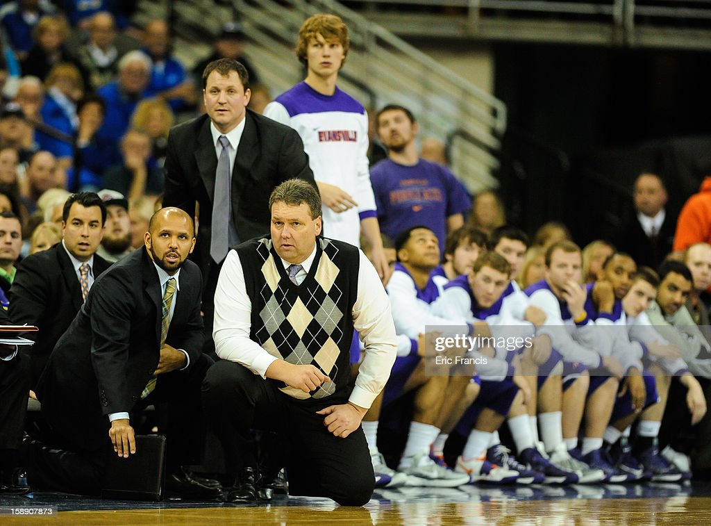 Head coach Marty Simmons and assistants Carson Harris, Jim Elgas, and Geoff Alexander of the Evansville Aces during their game against the Creighton Bluejays at the CenturyLink Center on December 29, 2012 in Omaha, Nebraska. Creighton defeated Evansville 87-70.