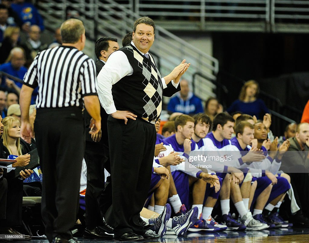 Head coach Marty Simmons of the Evansville Aces smiles at a referee during their game against the Creighton Bluejays at the CenturyLink Center on December 29, 2012 in Omaha, Nebraska. Creighton defeated Evansville 87-70.