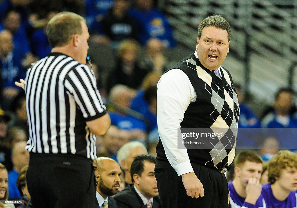 Head coach Marty Simmons of the Evansville Aces talks to a referee during their game against the Creighton Bluejays at the CenturyLink Center on December 29, 2012 in Omaha, Nebraska. Creighton defeated Evansville 87-70.
