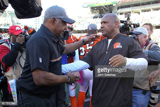 Head Coach Marvin Lewis of the Cincinnati Bengals and Head Coach Hue Jackson of the Cleveland Browns shake hands after the completion of the game at...