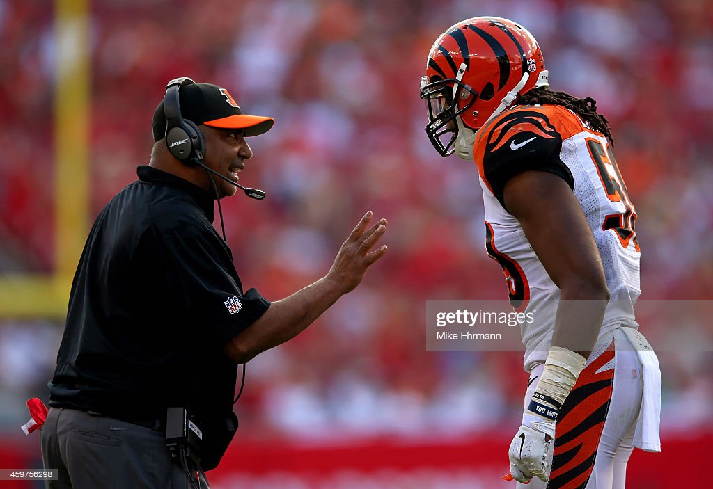 Head coach <a gi-track='captionPersonalityLinkClicked' href=/galleries/search?phrase=Marvin+Lewis+-+Coach&family=editorial&specificpeople=211207 ng-click='$event.stopPropagation()'>Marvin Lewis</a> of the Cincinnati Bengals talks with <a gi-track='captionPersonalityLinkClicked' href=/galleries/search?phrase=Emmanuel+Lamur&family=editorial&specificpeople=6335983 ng-click='$event.stopPropagation()'>Emmanuel Lamur</a> #59 during a game against the Tampa Bay Buccaneers at Raymond James Stadium on November 30, 2014 in Tampa, Florida.