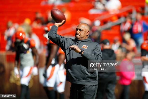Head coach Marvin Lewis of the Cincinnati Bengals throws the ball during warm ups in the game against the Cleveland Browns at FirstEnergy Stadium on...