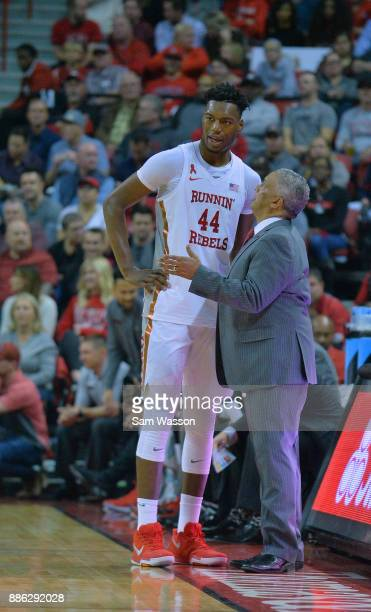 Head coach Marvin Menzies of the UNLV Rebels talks to Brandon McCoy of the UNLV Rebels during their game against the Arizona Wildcats at the Thomas...