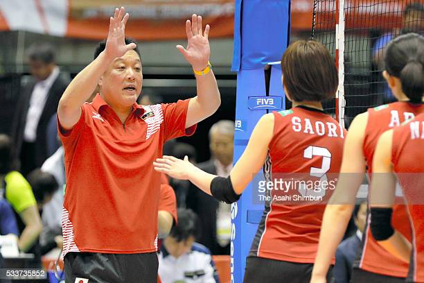 Head coach Masayoshi Manabe of Japan welcomes his players after the Women's World Olympic Qualification game between Japan and Italy at Tokyo...