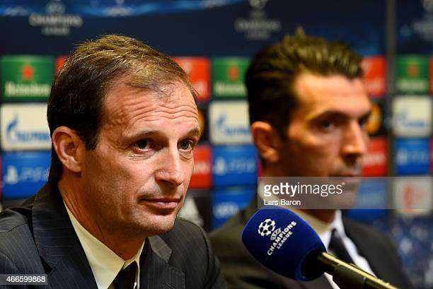 Head coach Massimiliano Allegri is seen next to Gianluigi Buffon during a Juventus Turin press conference at Signal Iduna Park on March 17 2015 in...