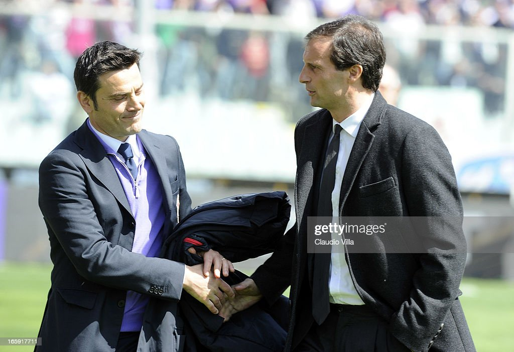 Head coach Massimiliano Allegri of AC Milan (R) greets head coach Vincenzo Montella of ACF Fiorentina before the Serie A match between ACF Fiorentina and AC Milan at Stadio Artemio Franchi on April 7, 2013 in Florence, Italy.
