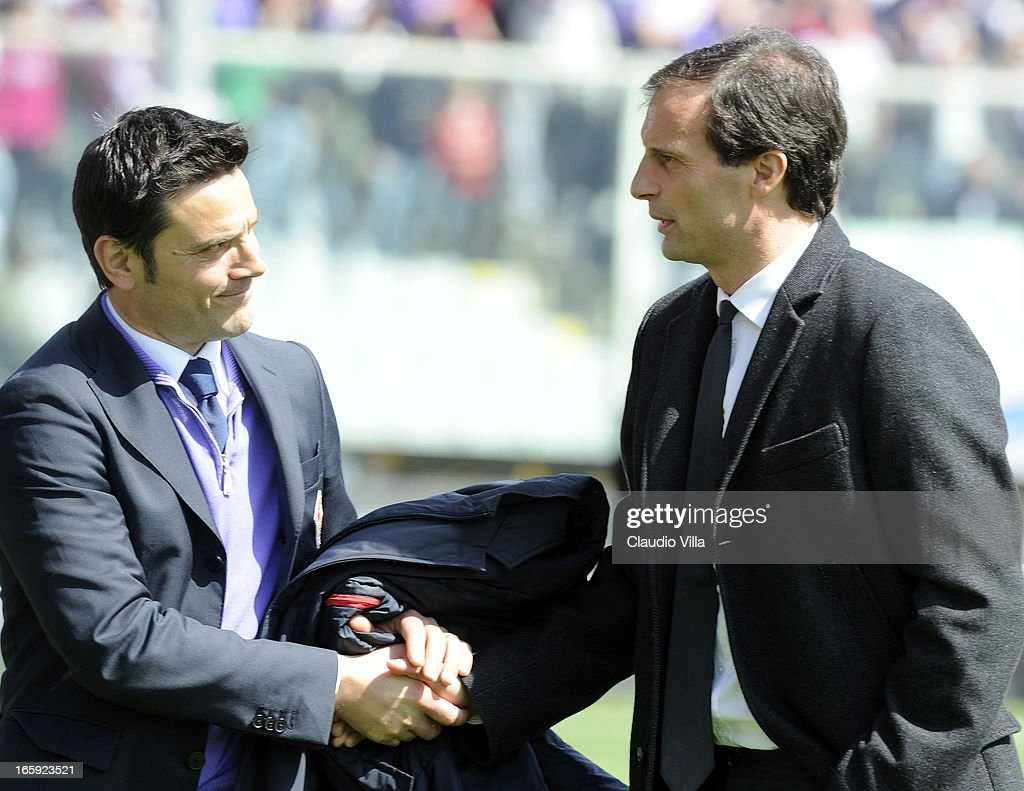 Head coach <a gi-track='captionPersonalityLinkClicked' href=/galleries/search?phrase=Massimiliano+Allegri&family=editorial&specificpeople=3470667 ng-click='$event.stopPropagation()'>Massimiliano Allegri</a> of AC Milan (R) greets head coach <a gi-track='captionPersonalityLinkClicked' href=/galleries/search?phrase=Vincenzo+Montella&family=editorial&specificpeople=217766 ng-click='$event.stopPropagation()'>Vincenzo Montella</a> of ACF Fiorentina before the Serie A match between ACF Fiorentina and AC Milan at Stadio Artemio Franchi on April 7, 2013 in Florence, Italy.
