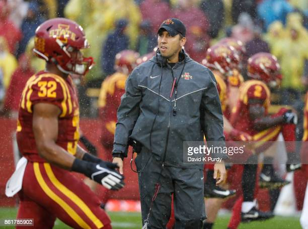 Head coach Matt Campbell of the Iowa State Cyclones coaches during warm ups before game action against the Kansas Jayhawks in the first half of play...