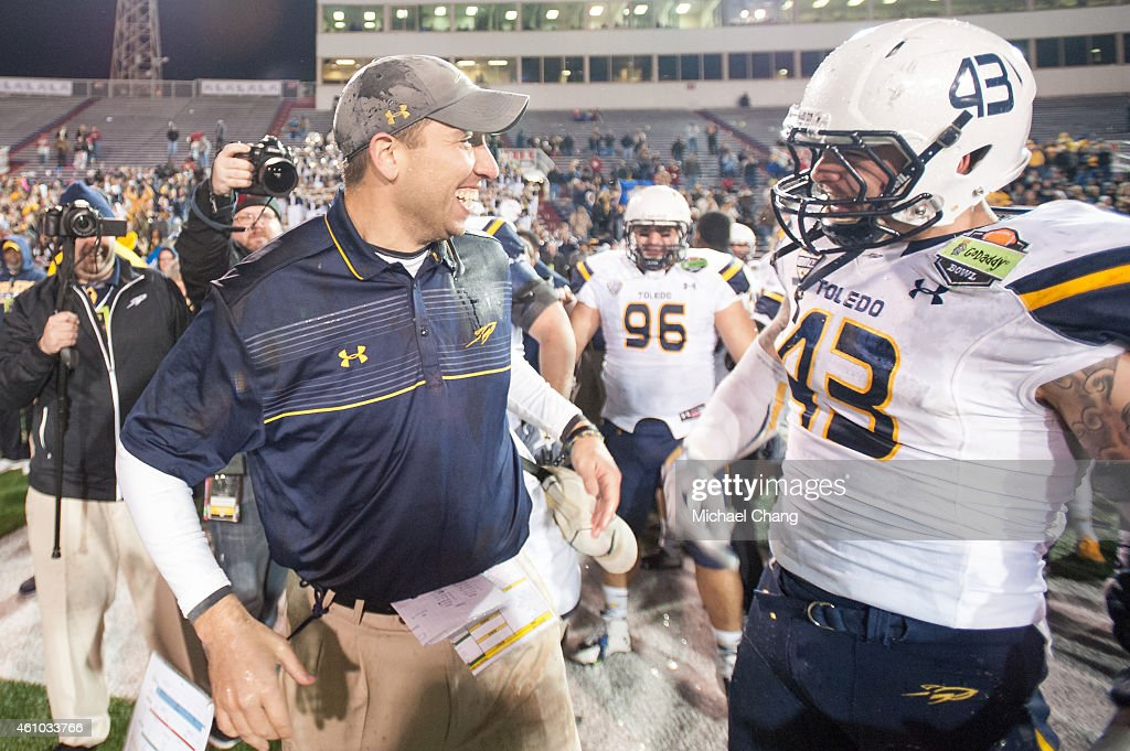 Head coach <a gi-track='captionPersonalityLinkClicked' href=/galleries/search?phrase=Matt+Campbell&family=editorial&specificpeople=2523847 ng-click='$event.stopPropagation()'>Matt Campbell</a> of the Toledo Rockets celebrates with linebacker Trent Voss #43 of the Toledo Rockets during their game against the Arkansas State Red Wolves on January 4, 2015 at Ladd-Peebles Stadium in Mobile, Alabama. The Toledo Rockets defeated the Arkansas State Red Wolves 63-44.