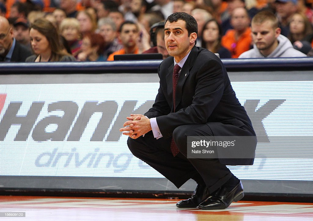 Head coach Matt Langel of the Colgate Raiders kneels on the sideline as he looks on during the game against the Syracuse Orange at the Carrier Dome on November 25, 2012 in Syracuse, New York.