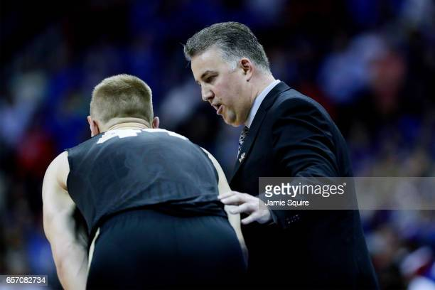 Head coach Matt Painter speaks with Isaac Haas of the Purdue Boilermakers against the Kansas Jayhawks during the 2017 NCAA Men's Basketball...
