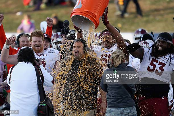 Head coach Matt Rhule of the Temple Owls is doused during the closing moments of the Owls 3410 win over the Navy Midshipmen during the AAC...