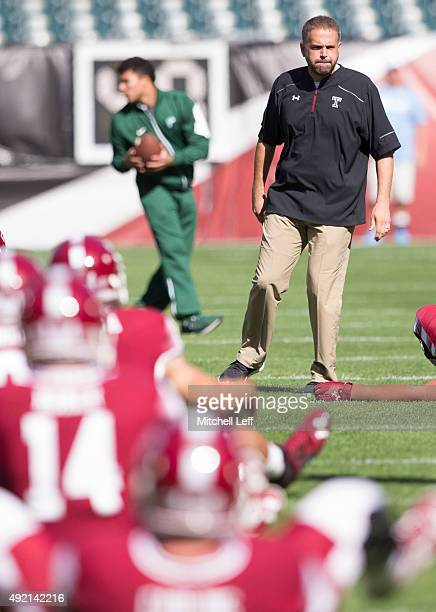 Head coach Matt Rhule of the Temple Owls looks on as his team stretches prior to the game against the Tulane Green Wave on October 10 2015 at Lincoln...