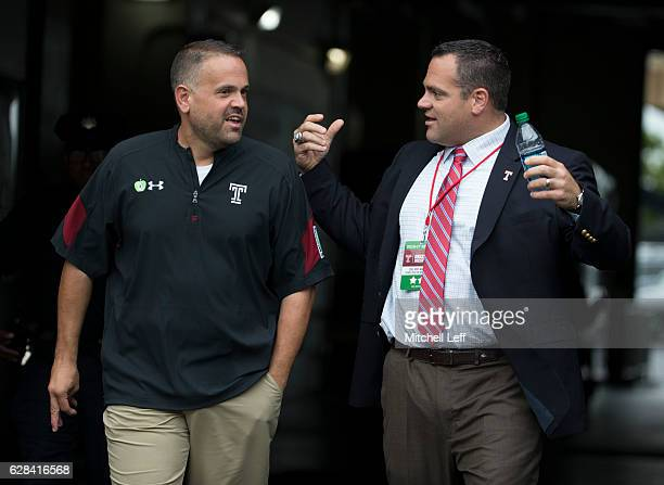 Head coach Matt Rhule of the Temple Owls talks to athletic director Dr Pat Kraft prior to the game against the Charlotte 49ers at Lincoln Financial...