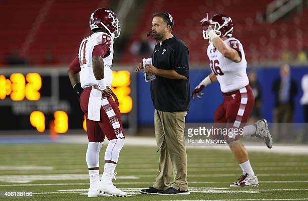 Head coach Matt Rhule of the Temple Owls talks with PJ Walker during play against the Southern Methodist Mustangs in the second half at Gerald J Ford...