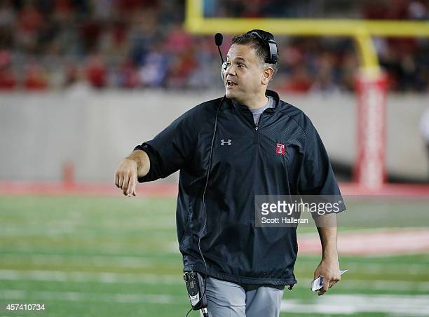 Head coach Matt Rhule of the Temple Owls walks near the sideline the field in the first half of their game against the Houston Cougars at TDECU...