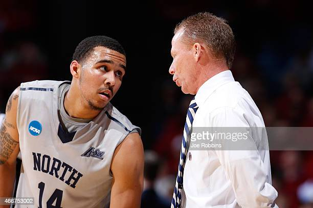 Head coach Matthew Driscoll speaks with Dallas Moore of the North Florida Ospreys against the Robert Morris Colonials during the first round of the...