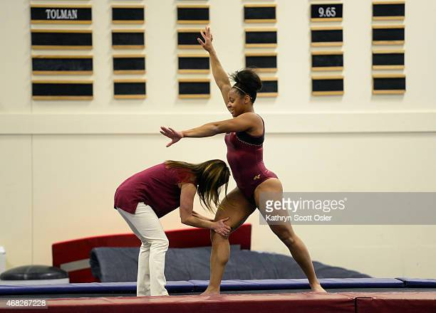 Head coach Melissa KutcherRinehart works with gymnast Nina McGee The University of Denver Gymnastics team heads to Ames Iowa for the NCAA regional...