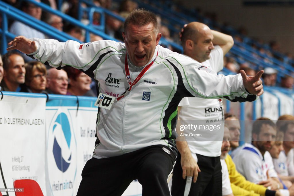 Head coach <a gi-track='captionPersonalityLinkClicked' href=/galleries/search?phrase=Michael+Biegler&family=editorial&specificpeople=2506225 ng-click='$event.stopPropagation()'>Michael Biegler</a> of Grosswallstadt reacts during the Toyota Handball Bundesliga match between TV Grosswallstadt and THW Kiel at the Frankenstolz Arena on November 2, 2010 in Aschaffenburg, Germany.