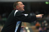Head coach Michael Biegler of Magdeburg issues instructions to the team during the Toyota Handball Bundesliga match between HSG Duesseldorf and SC...