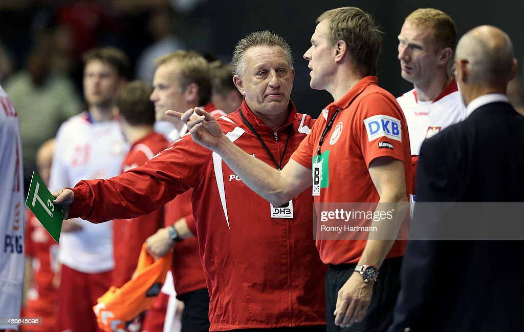 Head coach Michael Biegler of Poland argues with head coach Martin Heuberger of Germany during the IHF World Championship 2015 Playoff Leg Two...