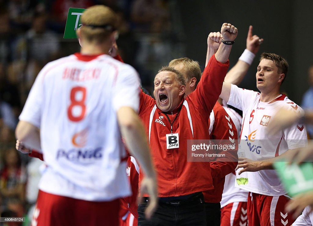 Head coach Michael Biegler of Poland celebrates during the IHF World Championship 2015 Playoff Leg Two between Germany and Poland at GetecArena on...