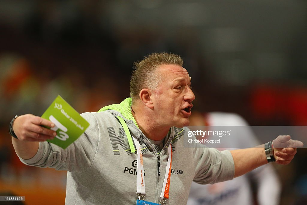 Head coach Michael Biegler of Poland issues instructions during the IHF Men's Handball World Championship group D match between Poland and Russia at...
