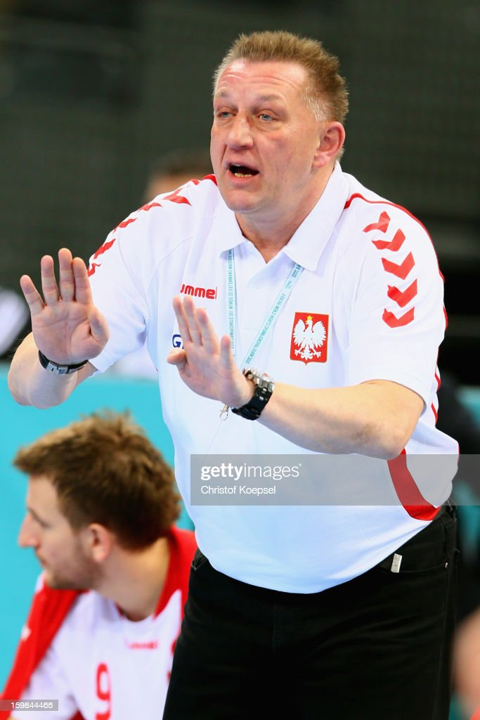 Head coach <a gi-track='captionPersonalityLinkClicked' href=/galleries/search?phrase=Michael+Biegler&family=editorial&specificpeople=2506225 ng-click='$event.stopPropagation()'>Michael Biegler</a> of Poland looks dejected during the round of sixteen match between Hungary and Poland at Palau Sant Jordi on January 21, 2013 in Barcelona, Spain.