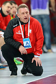 Head coach Michael Biegler of Poland looks on during the IHF Men's Handball World Championship group D match between Poland and Germany at Lusail...