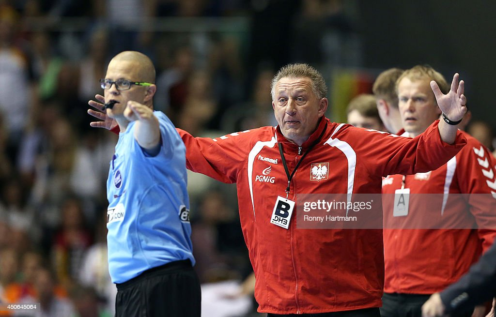 Head coach <a gi-track='captionPersonalityLinkClicked' href=/galleries/search?phrase=Michael+Biegler&family=editorial&specificpeople=2506225 ng-click='$event.stopPropagation()'>Michael Biegler</a> (C) of Poland reacts during the IHF World Championship 2015 Playoff Leg Two between Germany and Poland at Getec-Arena on June 14, 2014 in Magdeburg, Germany.