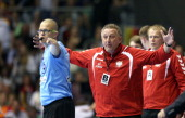 Head coach Michael Biegler of Poland reacts during the IHF World Championship 2015 Playoff Leg Two between Germany and Poland at GetecArena on June...