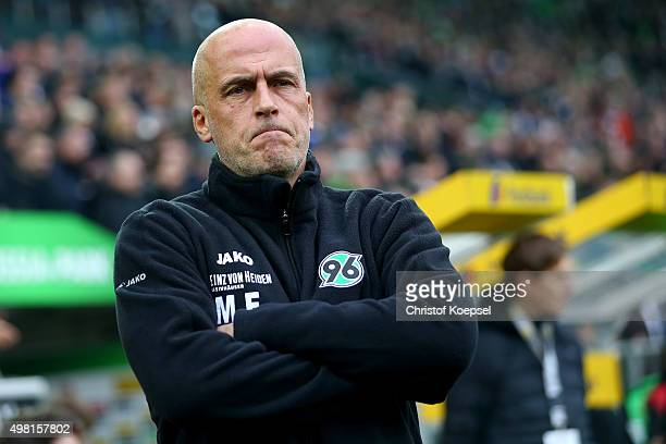 Head coach Michael Frontzeck of Hannover looks thoughtful during the Bundesliga match between Borussia Moenchengladbach and Hannover 96 at...