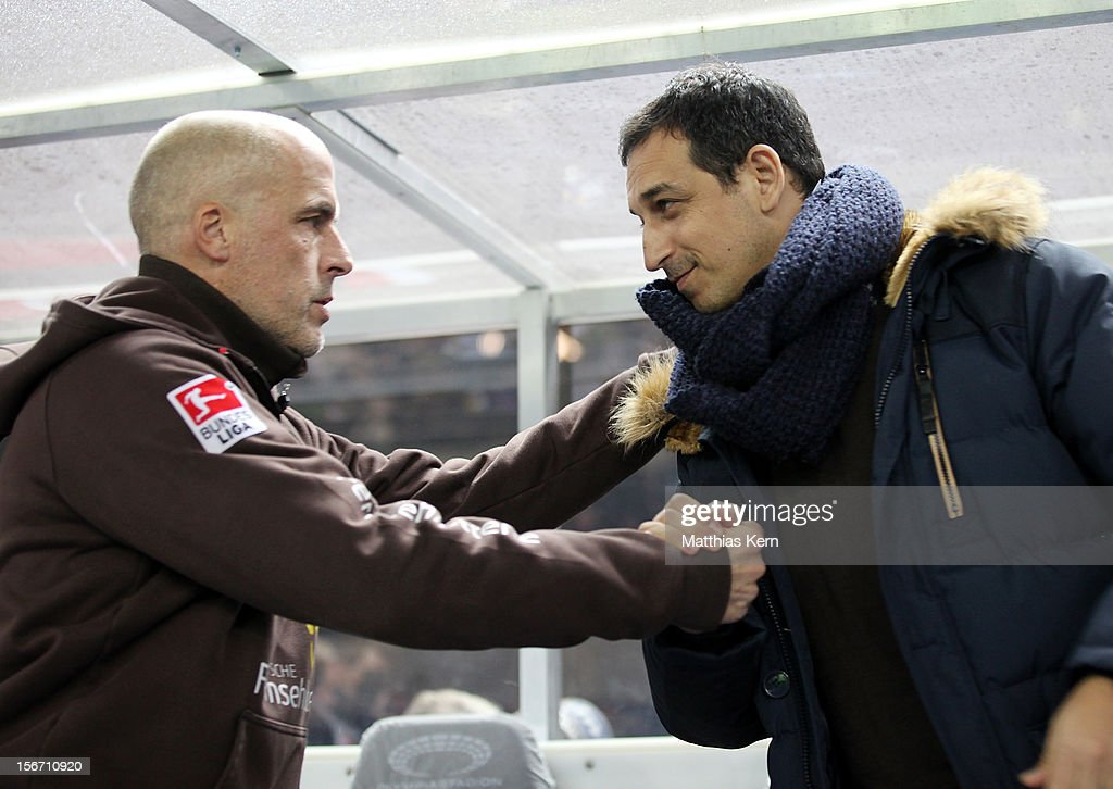 Head coach Michael Frontzeck (L) of St. Pauli and manager Rachid Azzouzi (R) look on prior to the Second Bundesliga match between Hertha BSC Berlin and FC St. Pauli at Olympic stadium on November 19, 2012 in Berlin, Germany.