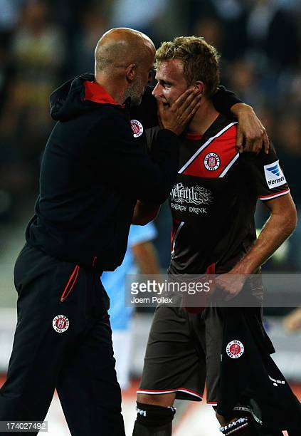 Head coach Michael Frontzeck of St Pauli celebrates with Lennart Thy of St Pauli after the Second Bundesliga match between FC St Pauli and 1860...