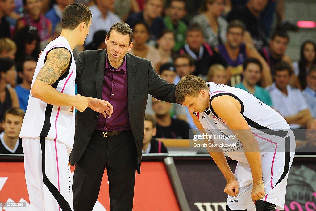 Head coach Michael Koch of Bonn talks to Zvonko Buljan and Chris Ensminger during the Beko BBL Bundesliga match between Telekom Baskets Bonn and FC...