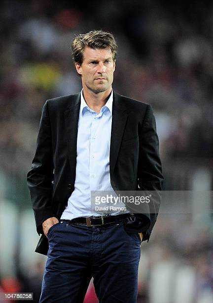 Head coach Michael Laudrup of Mallorca watches the game during the La Liga match between Barcelona and Mallorca at the Camp Nou stadium on October 3...
