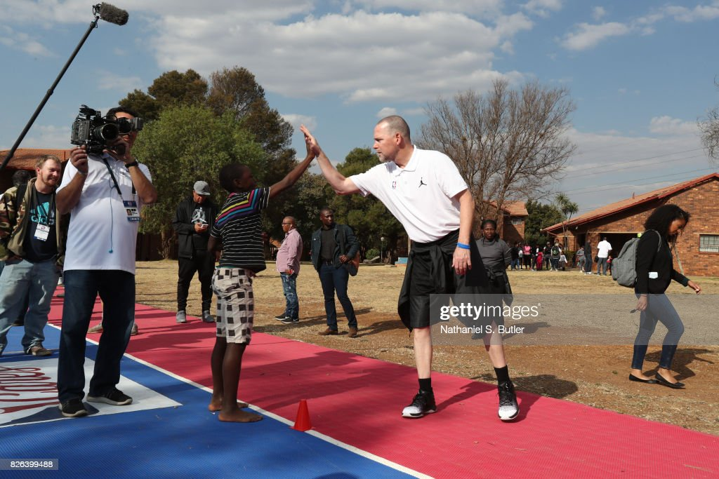 Head Coach Michael Malone of Team Africa interacts with the children as part of the Basketball Without Borders Africa at the SOS Children's Village on August 4, 2017 in Gauteng province of Ennerdale, South Africa.