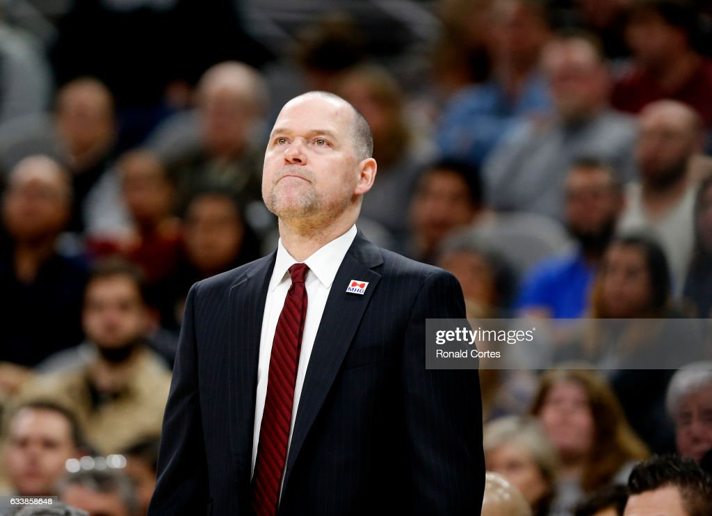 Head coach Michael Malone of the Denver Nuggets checks out replay during time-out against the San Antonio Spurs at AT&T Center on November 5, 2016 in San Antonio, Texas.