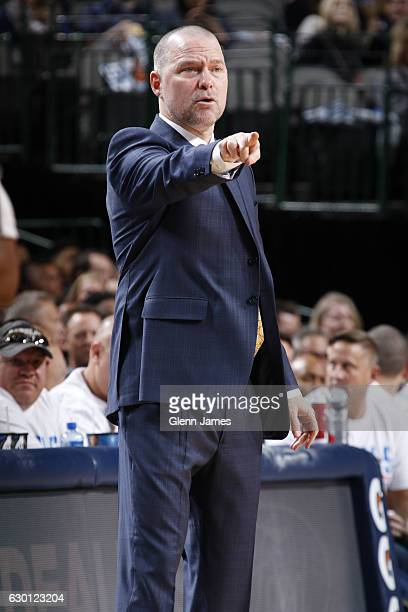 Head Coach Michael Malone of the Denver Nuggets coaches during the game against the Dallas Mavericks on December 12 2016 at the American Airlines...