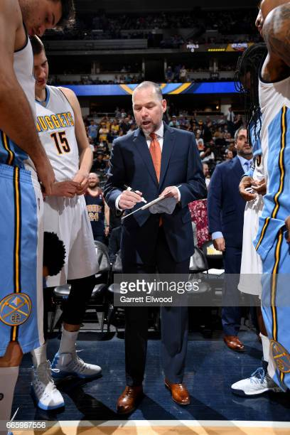 Head Coach Michael Malone of the Denver Nuggets coaches during the game against the New Orleans Pelicans on April 7 2017 at the Pepsi Center in...
