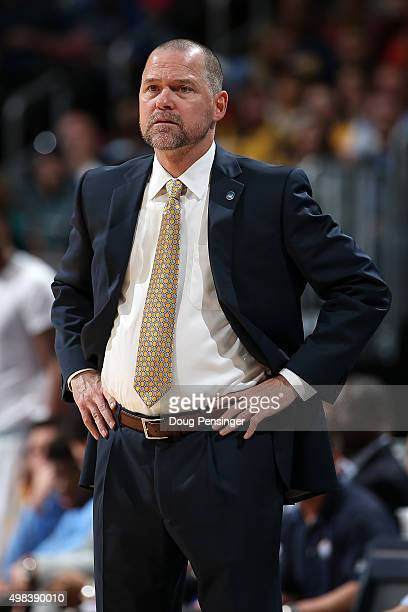 Head coach Michael Malone of the Denver Nuggets leads his team against the Golden State Warriors at Pepsi Center on November 22 2015 in Denver...