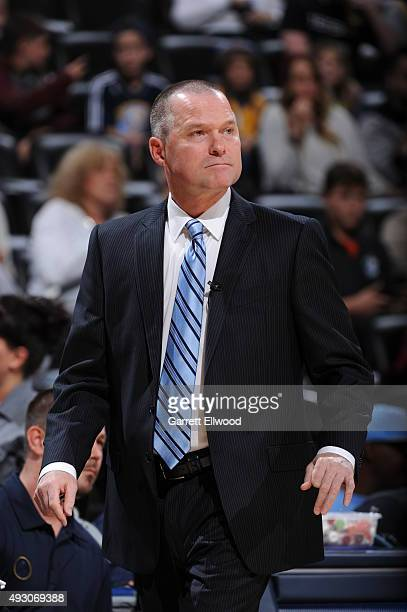 Head coach Michael Malone of the Denver Nuggets looks on against the Phoenix Suns during a preseason game on October 16 2015 at the Pepsi Center in...