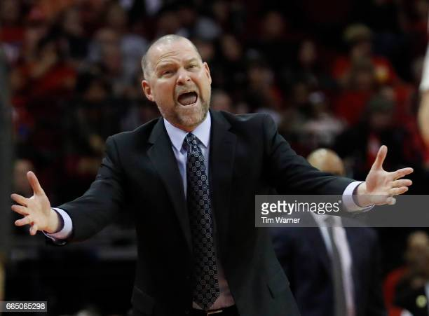 Head coach Michael Malone of the Denver Nuggets reacts to a call in the first half against the Houston Rockets at Toyota Center on April 5 2017 in...
