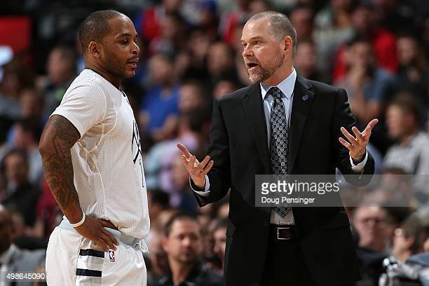 Head coach Michael Malone of the Denver Nuggets talks to Jameer Nelson of the Denver Nuggets as they face the Los Angeles Clippers at Pepsi Center on...