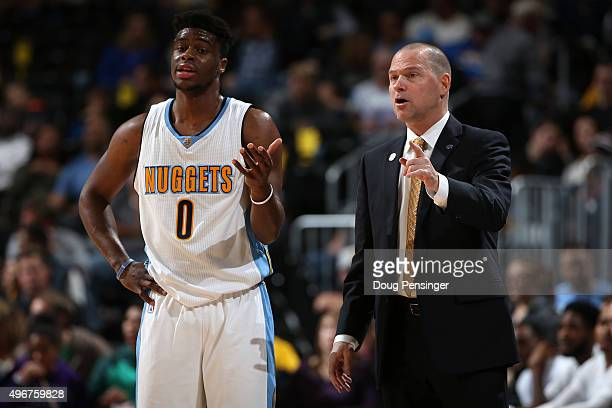 Head coach Michael Malone of the Denver Nuggets talks with Emmanuel Mudiay of the Denver Nuggets during a break in the action against the Milwaukee...