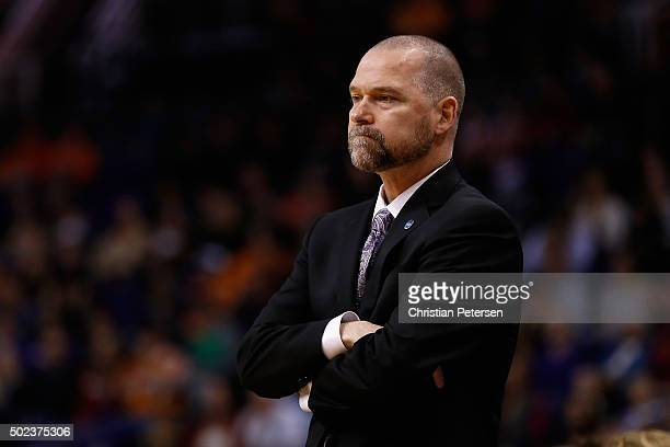 Head coach Michael Malone of the Denver Nuggets watches from the bench during the first half of the NBA game against the Phoenix Suns at Talking...