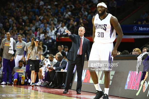 Head Coach Michael Malone of the Sacramento Kings calls a play against the Brooklyn Nets during the 2014 NBA Global Games at the MercedesBenz Arena...