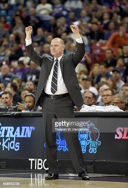 Head coach Michael Malone of the Sacramento Kings calls out to his team on the floor against the Denver Nuggets during the second half of their game...
