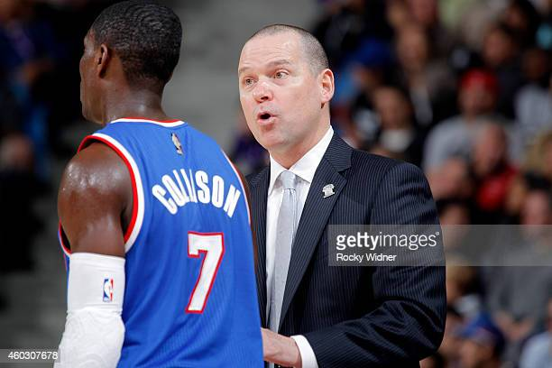 Head coach Michael Malone of the Sacramento Kings coaches his player Darren Collison against the Indiana Pacers on December 5 2014 at Sleep Train...